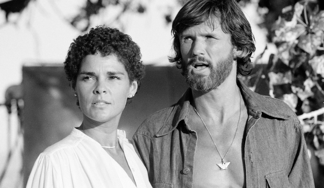 "Kris Kristofferson mit Ali McGraw in dem Film ""Convoy"" (1978)."